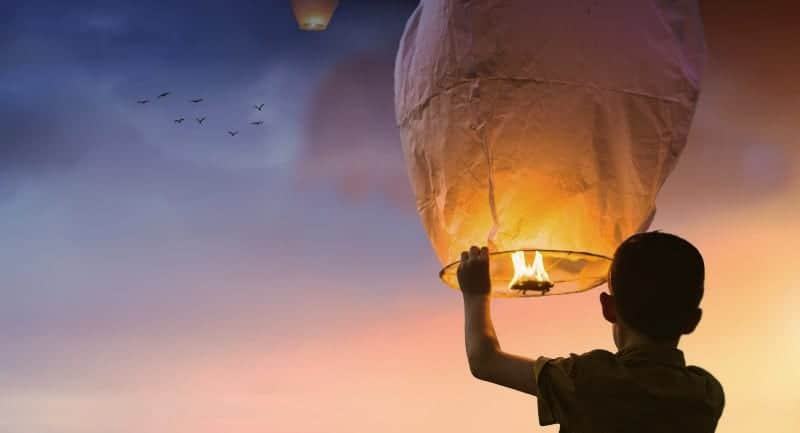 Letting go ceremony with giant Chinese lantern released.